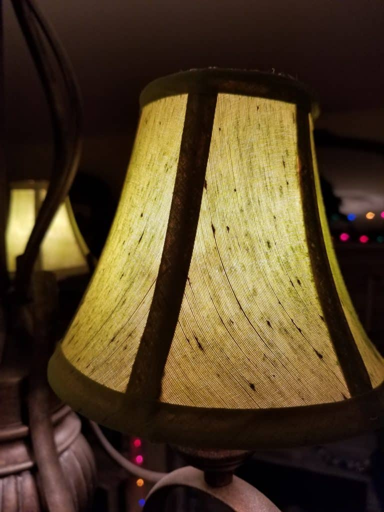 Updating a chandelier with Painted Lampshades