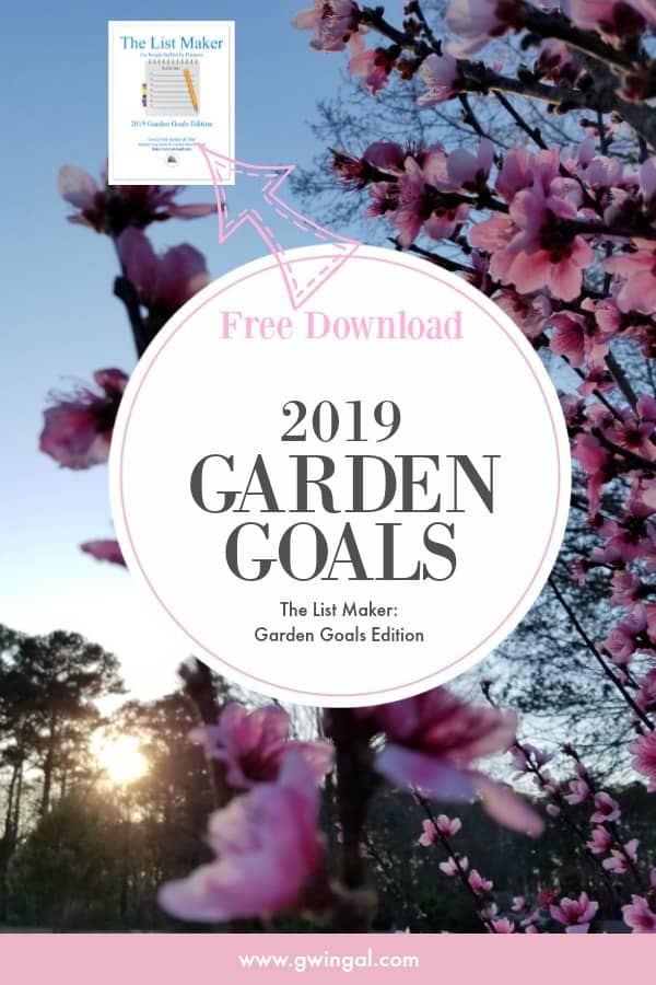 Sun setting in blue sky behind pink peach blossoms 2019 Garden Goals List Maker