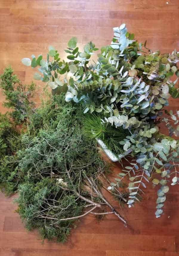pile of cedar limbs, pine cuttings, and eucalyptus cuttings