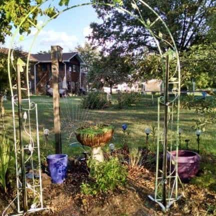 A purple Themed Garden with white arched trellis
