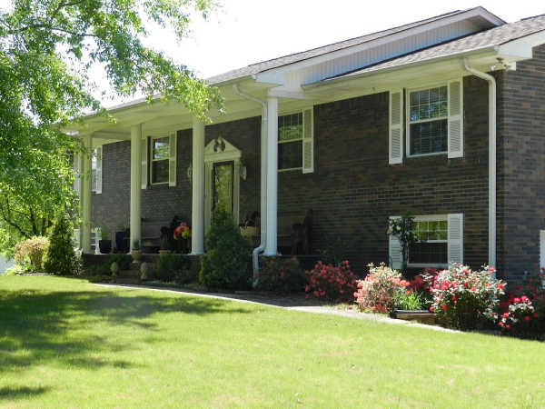 brick home with large white columns
