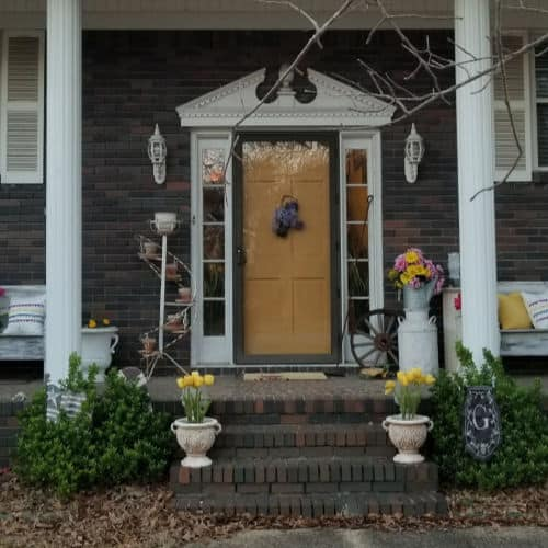 Yellow Door, with blue flowers, yellow flowers on steps